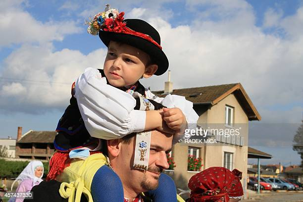 People wearing folk costumes attend an imperial feast in Vracov South Moravia Czech Republic 60 km southeast of Brno on October 18 2014 AFP PHOTO/...