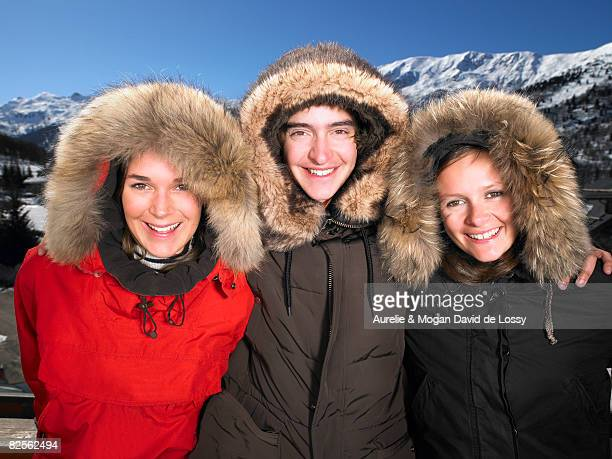 people wearing furry hooded jackets - fur jacket stock pictures, royalty-free photos & images