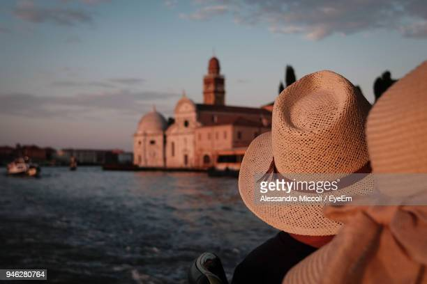 people wearing hat on boat at river during sunset - alessandro miccoli stockfoto's en -beelden