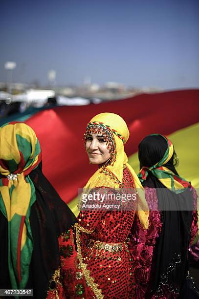 People wearing local dress attend the Newroz festival celebrations organized by Peoples Democratic Party in Istanbul Turkey on March 22 2015