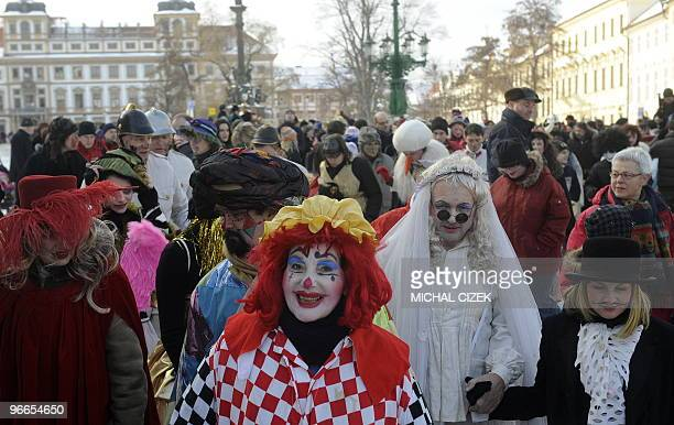 People wearing mask attend a traditional 'Mala Strana Carnival' festival celebrating the departing winter and forthcoming spring on February 13 in...