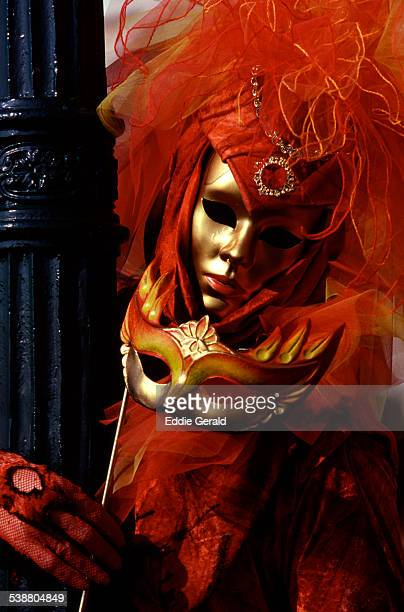 People wearing masked carnival costume during the Carnival of Venice Italy
