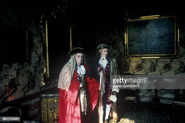People wearing masks and splendid garments attend the Venice Carnival in Venice 23 March 1993 Italy