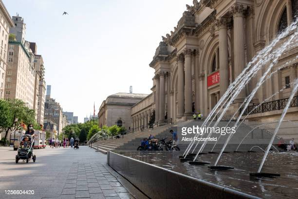 People wearing masks are seen outside The Metropolitan Museum of Art as the city moves into Phase 3 of reopening following restrictions imposed to...