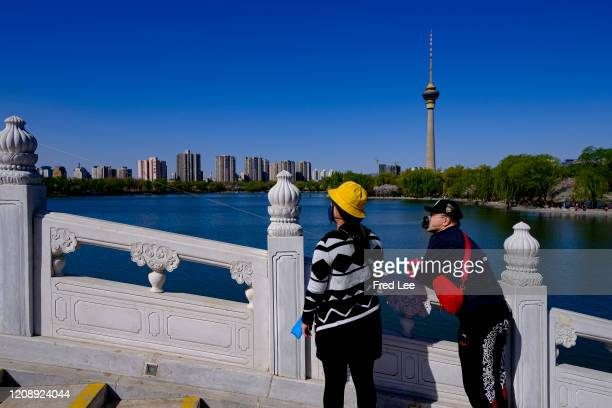 People wearing masks as part of precautionary measures against the spread of the COVID19 on April 02 2020 in Beijing China Health authorities of...