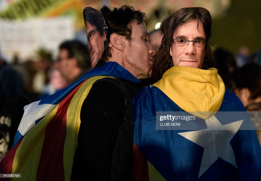People wearing masks depicting ousted separatist leader Carles Puigdemont attend a demonstration on January 30, 2018 in Barcelona. The speaker of Catalonia's parliament Roger Torrent delayed a key debate in the regional assembly on ousted separatist leader Carles Puigdemont's bid to form a new government, but defended his right to return to power. /