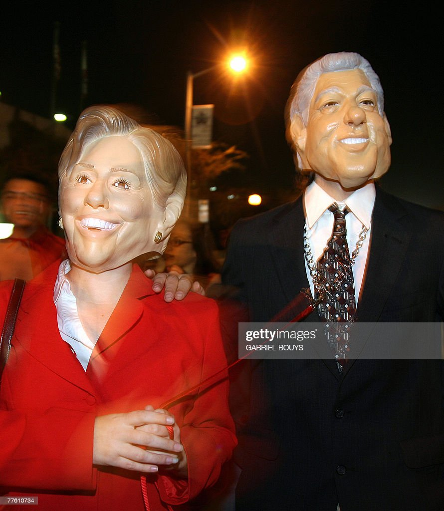 People wearing masks of former US president Bill Clinton and his wife New York Senator  sc 1 st  Getty Images & Los Angeles Halloween Parade Photos and Images | Getty Images