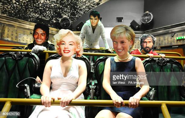People wearing masks of Jesus right join Michael Jackson Marilyn Monroe Elvis and Princess Diana for a ride on Vengeance at the London Dungeon