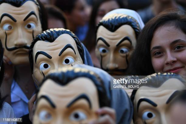 TOPSHOT People wearing masks of the Spanish TV show La Casa de Papel pose before a photocall for the presentation of the 3rd season of the show on...