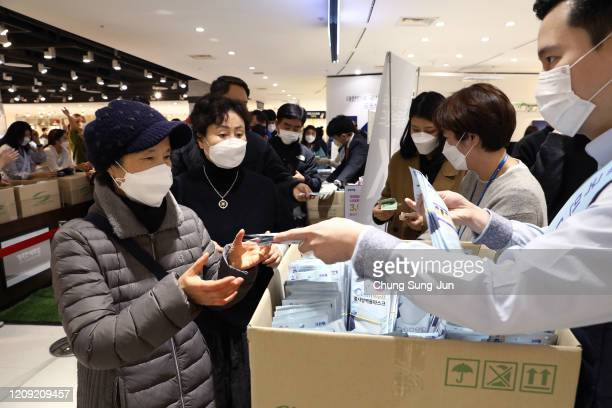 People wearing masks to prevent the coronavirus buy face masks at a department store on February 28 2020 in Seoul South Korea Government has raised...