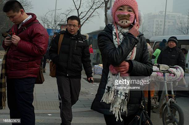 CONTENT] People wearing masks to protect themselves from air pollution record day