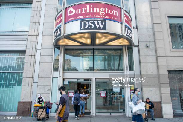 People wearing masks walk past Burlington Coat Factory and Designer Show Warehouse in Union Square as the city continues Phase 4 of re-opening...