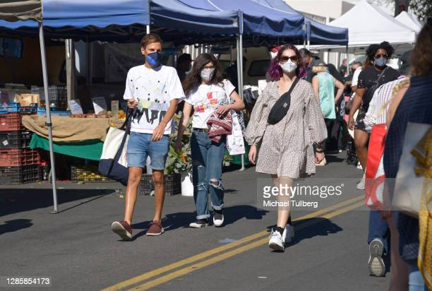 People wearing masks while shopping at the Hollywood Farmers Market on November 15, 2020 in Los Angeles, California. Cities across the United States...