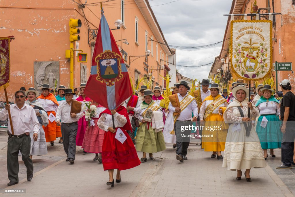 People wearing multicolored dresses and hats marching during the celebration of the Palm Sunday of Easter at Ayacucho city, Peru. : Stock Photo