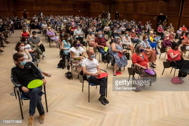 People, wearing protective face masks attend a campaign rally for the 12J autonomic elections at Kursaal on July 01, 2020 in San Sebastian, Spain....