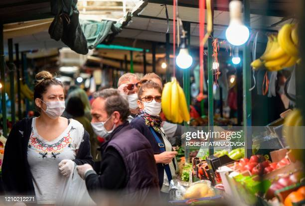 People wearing protective masks againt spread of the coronavirus shop at the green market on Easter Friday as they ready for the Easter celebrations...