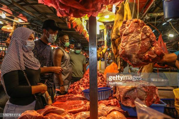 People wearing protective masks at the wet market in Kuala Lumpur, Malaysia on March 17, 2020. Malaysia will be under a nationwide movement control...