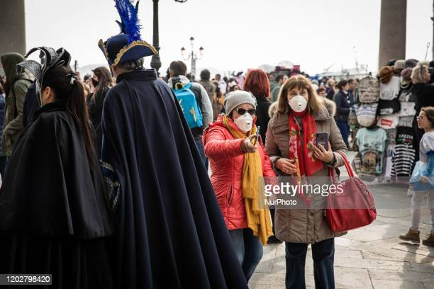 People wearing protective masks in Venice, Italy, on February 23, 2020 due to concerns over coronavirus infection. President of the Luca Zaia has...