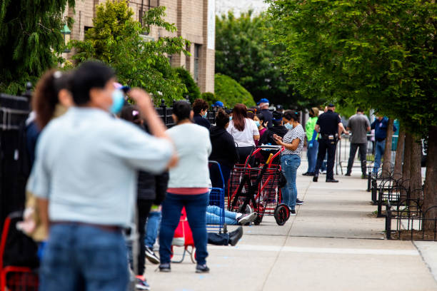 NY: Catholic Charities Brooklyn And Queens Pop Up Food Distribution Site As Demand On Food Banks Surge