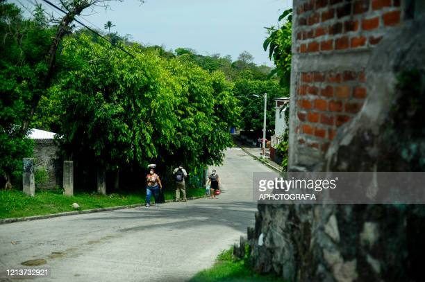 People wearing protective masks walk during government issued lockdown on May 18 2020 in Cuscatlan El Salvador The Supreme Justice Court has declared...