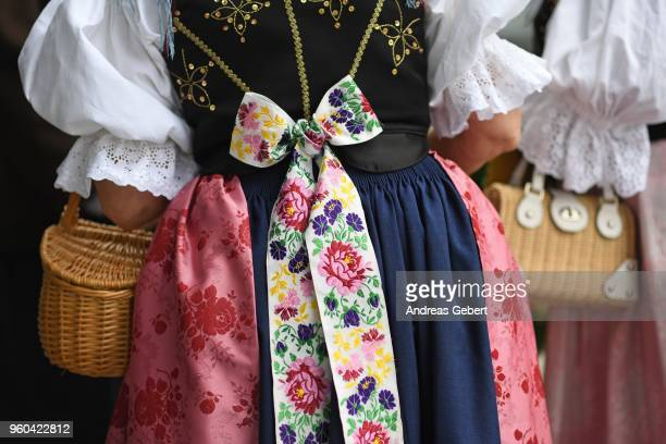 People wearing Sudeten folk dress gather to march into the convention hall during the annual gathering of the Sudendeutsche Volksgruppe the national...