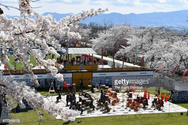 People wearing traditional armors and kimono act as peices of the Shogi or Japanese chess during the 'Ningen Shogi' at Mt Maizuru of the Tendo Park...