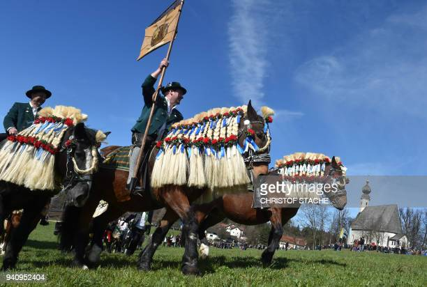 TOPSHOT People wearing traditional Bavarian costumes take part in the St Georgi Ride on Easter Monday on April 2 in Traunstein southern Germany The...