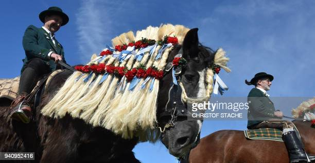 People wearing traditional Bavarian costumes take part in the St Georgi Ride on Easter Monday on April 2 in Traunstein southern Germany The annual...
