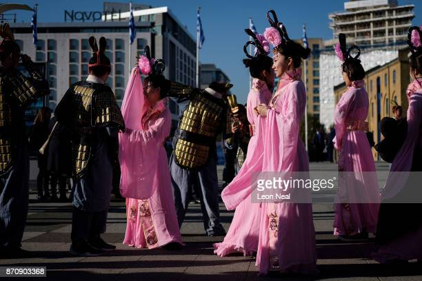 People wearing traditional Chinese dress chat after taking part in a photocall to promote the Shaanxi region of China at the World Travel Market...