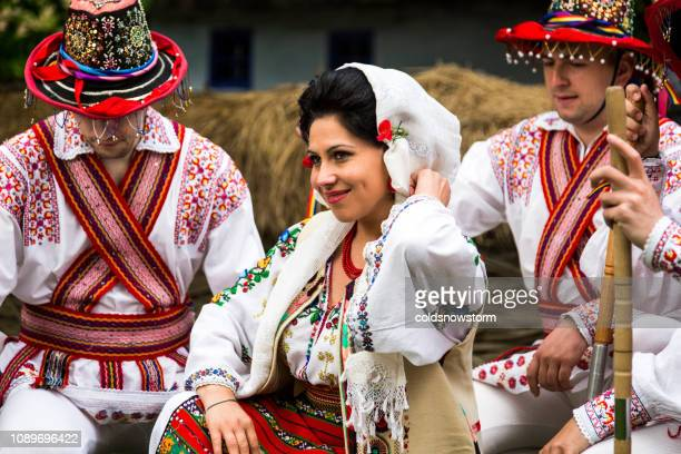 people wearing traditional romanian clothing in bucharest, romania - romania stock pictures, royalty-free photos & images