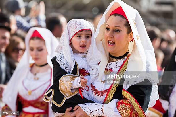 People wearing traditional Sardinian costumes are pictured during a cortege at the beginning of the Sartiglia in Oristano on the Island of Sardinia...
