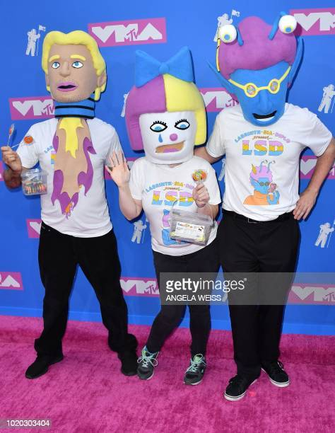 People wearing tshirts of collaborative music project LSD attend the 2018 MTV Video Music Awards at Radio City Music Hall on August 20 2018 in New...