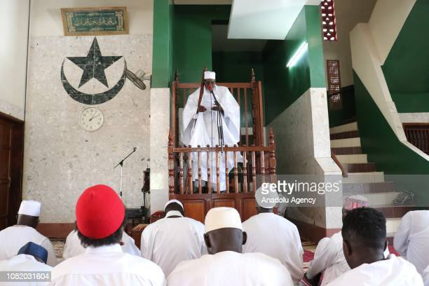 People wearing white clothes gather to perform the Friday prayer at Mosque of the Divine in Dakar Senegal on October 12 2018 The Mosque of the Divine...