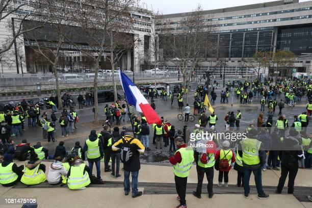 People wearing yellow vest gather in Bercy in front of the French Ministry for the Economy and Finance in Paris on January 12 2019 for an...