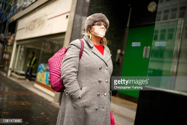 People weart face masks and PPE on October 22, 2020 in Sheffield, England. The county of South Yorkshire, which includes the city of Sheffield will...
