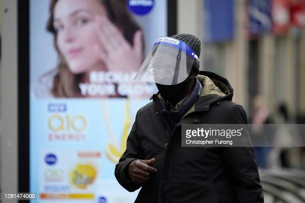 People weart face masks and PPE on October 22 2020 in Sheffield England The county of South Yorkshire which includes the city of Sheffield will move...