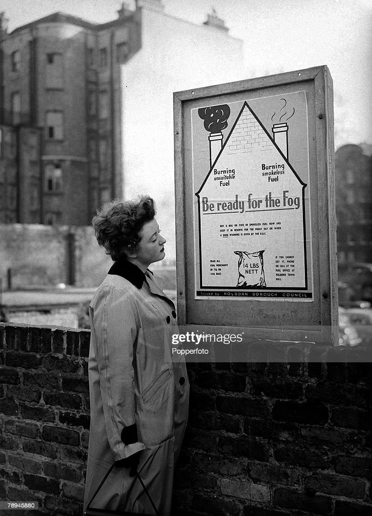 12th November 1954, London housewife reads a London borough of Holborn poster, warning of fog, During the early 1950's coal burning mixed with dense fogs caused the atmosphere in the city to become dangerous causing 'smog' when this mixture caused a toxic polluting blanket