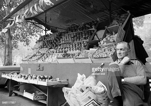 People, weekly market, market stall with fruit and vegetables, salesman, marketer, aged 60 to 75 years, Italy, Lombardy, Milan -