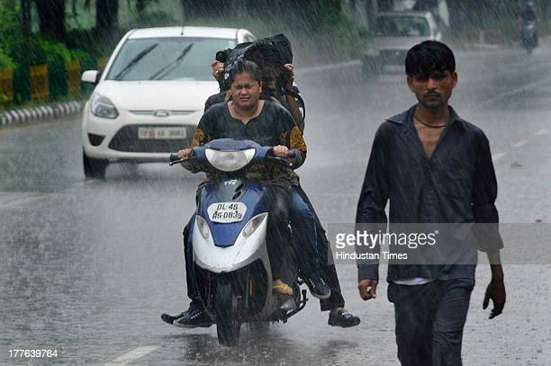 People were caught during the heavy rainfall on August 25, 2013 in Noida, India. Many parts of Delhi/Noida experienced heavy rains in the afternoon...