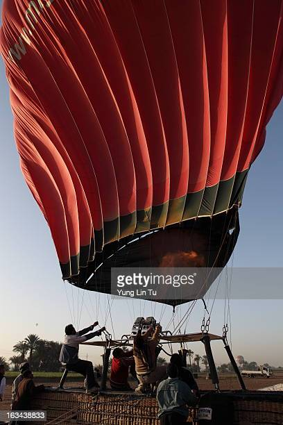 CONTENT] People were working hard to inflate our hot air balloon heated air was pumped open flame flared