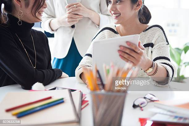 People who are using  tablet to a meeting in company