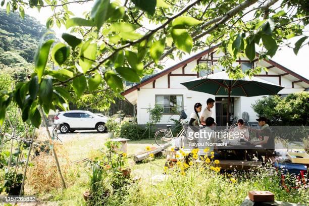 people who enjoy garden party - 郊外の風景 ストックフォトと画像