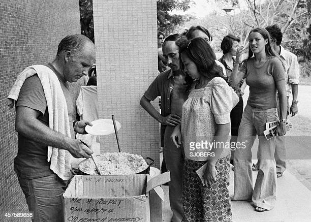 People who found shelter at the French Embassy in Phnom Penh are getting a meal late April 1975 On New Year's Day 1975 Communist troops led by Pol...