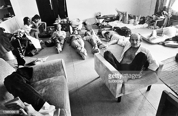 People who found shelter at the French Embassy in Phnom Penh rest in one of the room of the building late April 1975. On New Year's Day 1975,...