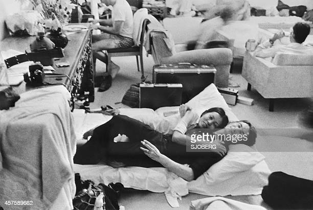 People who found shelter at the French Embassy in Phnom Penh rest in one of the room of the building late April 1975 On New Year's Day 1975 Communist...