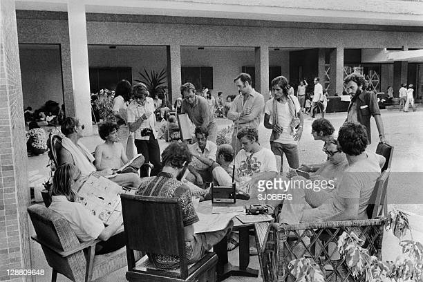 People who found shelter at the French Embassy in Phnom Penh wait in the yard of the building late April 1975. On New Year's Day 1975, Communist...