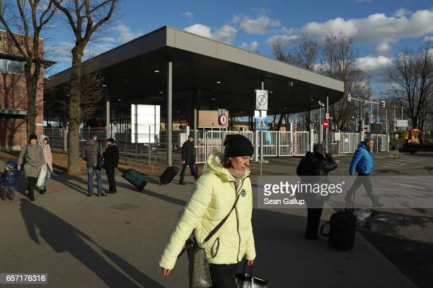 People who had just crossed from Russia into Estonia walk past the border control point on March 23 2017 in Narva Estonia Estonia is a member of the...