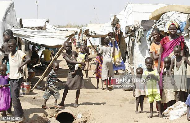 People who have fled fighting in South Sudan live in a refugee camp on the premises of a facility for the U.N. Peacekeeping mission in the capital...