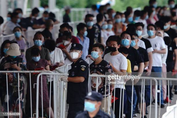 People who have had contact with the Xinfadi Wholesale Market or someone who has line up for a nucleic acid test for COVID19 at a testing center on...