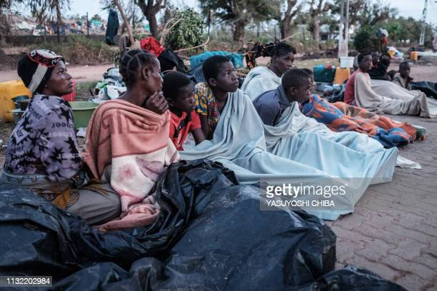 People who lost their home by the cyclone Idai wake up in the morning as they stay in shelter on a street in Buzi Mozambique on March 23 2019 The...